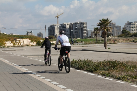 Cyclists on the bike path near sea photo