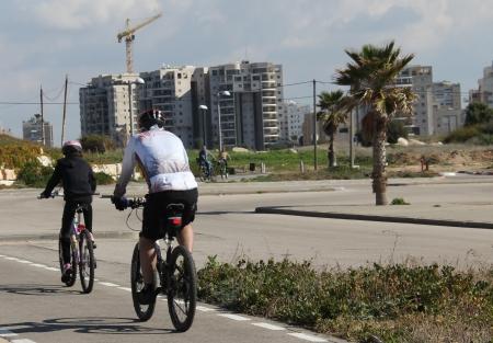 Cyclists on the bike path near sea photo