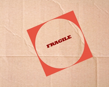 Fragile sign on cardboard photo