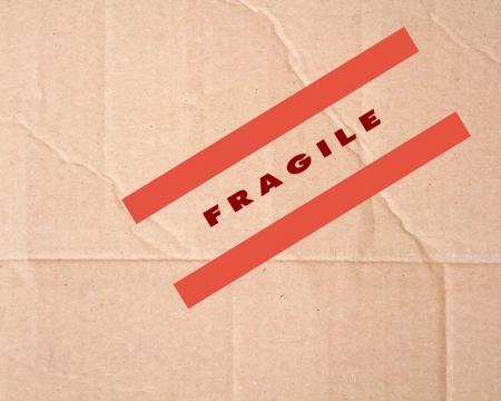 Fragile sign on cardboard photo