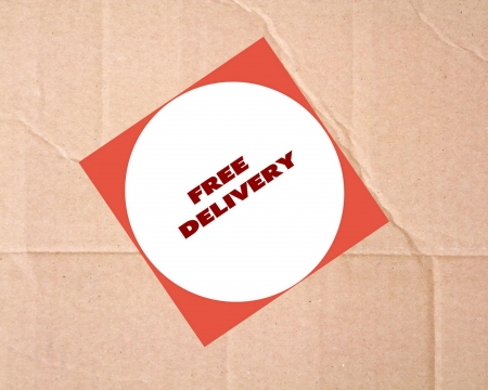 Free delivery sign on cardboard photo