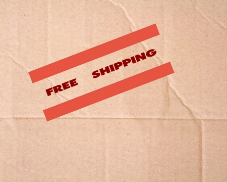 Free shipping sign on cardboard photo