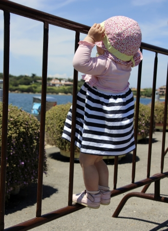 seven persons: Little cute blond girl  one year and seven months of age  at the port in Porto Cervo  Sardinia Stock Photo