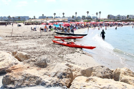 At the hot summer day  kayaks are resting  after a long voyage on the  Tel Baruch beach  in Tel Aviv, Israel  Tel Baruch beach -  one of the best vacation spots and water sports in Tel Aviv Stock Photo - 20805390