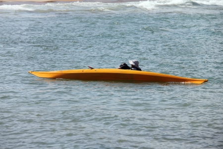 Training of lives saving  after kayak turning  in the hot summer day on beach Stock Photo - 20817844