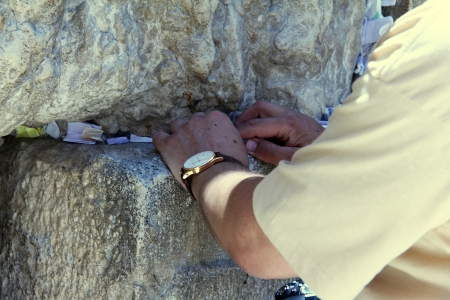 Placing a Note to God  in the Wailing Wall photo