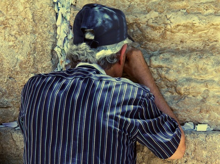 Jewish worshiper praying  at the Wailing Wall an important jewish religious site in Jerusalem, Israel Stock Photo