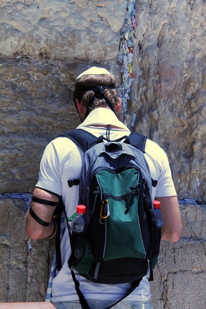 Jewish worshiper praying  at the Wailing Wall an important jewish religious site in Jerusalem, Israel photo
