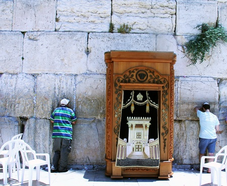 hassidic: Jewish worshipers praying  at the Wailing Wall an important jewish religious site in Jerusalem, Israel
