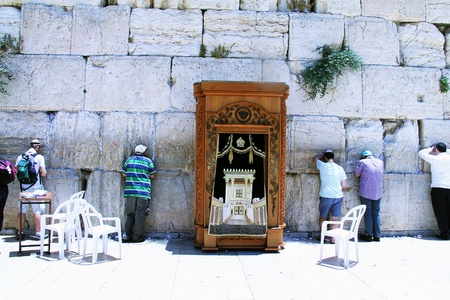 Jewish worshipers praying  at the Wailing Wall an important jewish religious site in Jerusalem, Israel