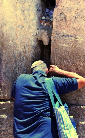hassidic: Jewish worshiper praying  at the Wailing Wall an important jewish religious site in Jerusalem, Israel Stock Photo