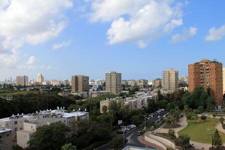 ramat aviv: Tel Aviv on blue cloudy background