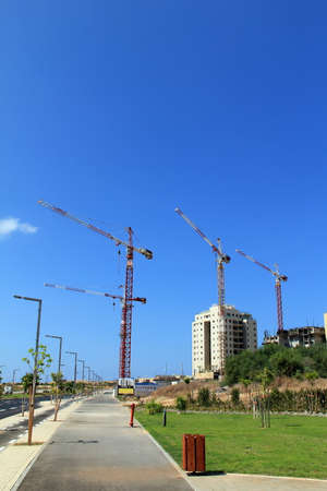 ramat aviv: TEL AVIV - SEPTEMBER 21:  Cranes on a construction site in Ramat Aviv on September 21, 2013 in Tel Aviv, Israel, Ramat Aviv- one of the most rapidly developing areas of the city