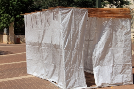 tabernacles: A sukkah is a temporary hut constructed for use during the week-long Jewish festival of Sukkot. It is topped with branches and often well decorated with autumnal, harvest or Judaic themes. Stock Photo