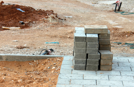 sidewalk construction and stack of concrete blocks Stock Photo
