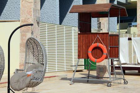 Lifeguard tower at the swimming pool and lifebuoy photo