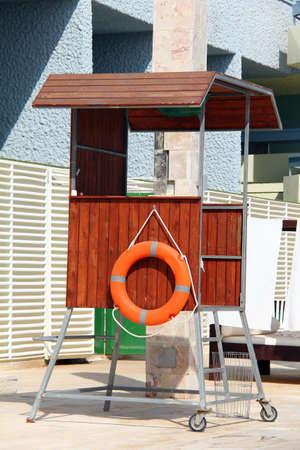 lifeguard tower: Lifeguard tower at the swimming pool and lifebuoy