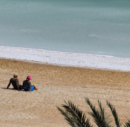 musculoskeletal:  Young couple taking mud treatment outdoor on summer day by Dead sea  Neve Zoar, Israel  Stock Photo