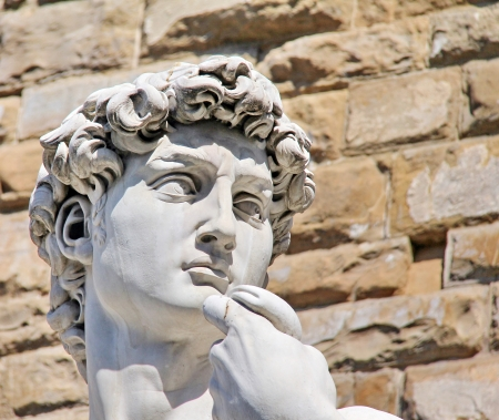 Detail close-up of Michelangelo s David statue on stone wall background   Florence  Italy