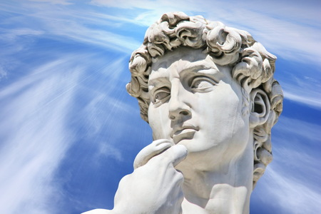 nudist: Detail close-up of Michelangelo s David statue on blue sky background   Florence  Italy