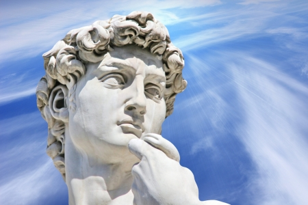 Detail close-up of Michelangelo s David statue on blue sky background   Florence  Italy