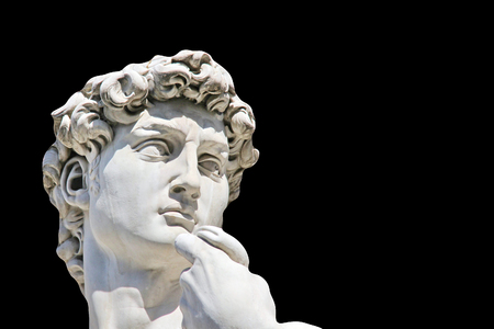 Detail close-up of Michelangelo s David statue on black background, with place for your design or text Фото со стока