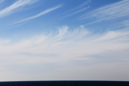 Deep Blue Sea and beautiful wispy cloud photo