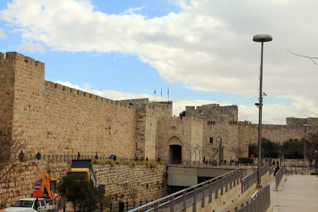 Surrounding wall of the old city of Jerusalem near Jaffa gate beneath a spectacular  blue sky at winter