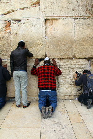 hassidic:  Jewish worshipers pray at the Wailing Wall an important jewish religious site at winter  Jerusalem, Israel Editorial