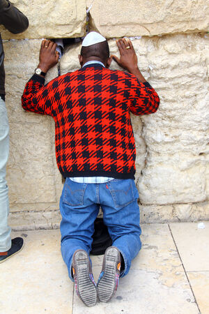 hassidic:  Jewish worshiper prays at the Wailing Wall an important jewish religious site at winter  Jerusalem, Israel