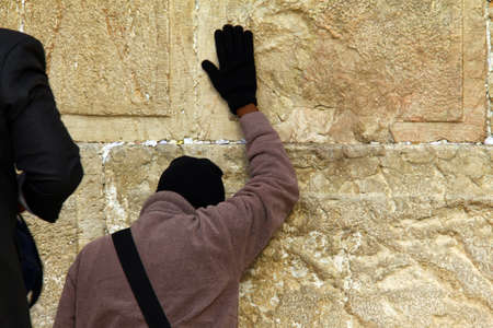 hassidic:   Jewish worshiper prays at the Wailing Wall an important jewish religious site at winter on December 9, 2013 in Jerusalem, Israel Editorial