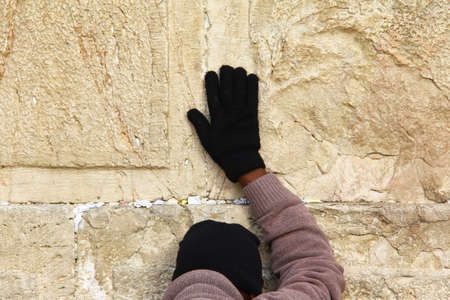 Jewish worshiper prays at the Wailing Wall an important jewish religious site at winter  Jerusalem, Israel