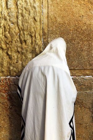 hassidic:  Jewish worshiper prays at the Wailing Wall an important jewish religious site at winter  in Jerusalem, Israel