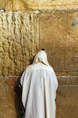 Jewish worshiper prays at the Wailing Wall an important jewish religious site at winter  in Jerusalem, Israel