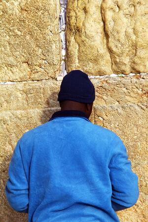 Jewish worshiper prays at the Wailing Wall an important jewish religious site at winter Jerusalem, Israel Editorial
