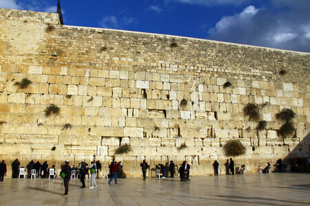 hassidic:  Jewish worshipers pray at the Wailing Wall an important jewish religious site at winter  Jerusalem  Israel