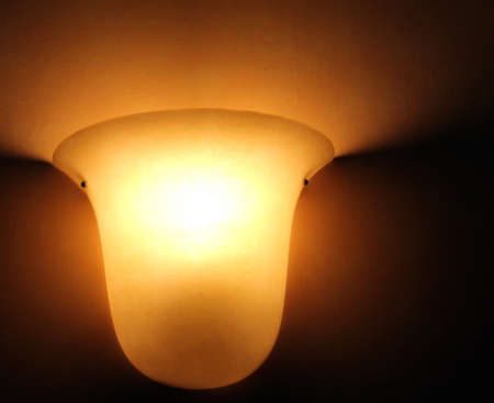 mottle:  Glass lamp on painted  old wall Stock Photo