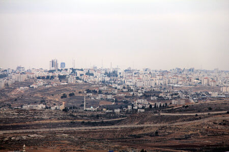 samuel: View of the security fence and Ramallah from Mount  of Prophet Samuel at the evening dark time