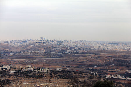 samuel: View of the security fence and Ramallah from Mount  of Prophet Samuel at the evening dark time  Jerusalem