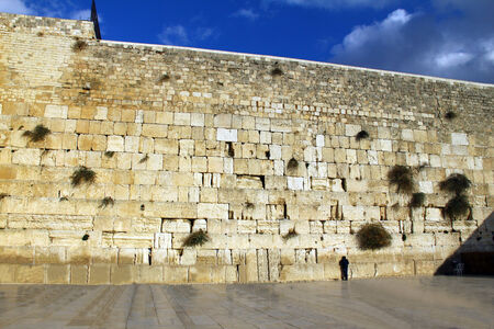 Jewish worshiper prays at the Wailing Wall an important jewish religious site at winter  in Jerusalem, Israel photo