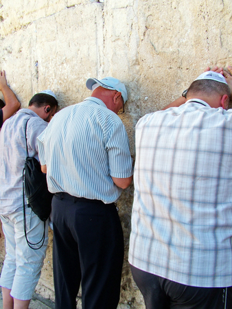 hassidic:  Jewish worshipers pray at the Wailing Wall an important jewish religious site in Jerusalem, Israel