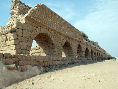 View of the ancient Roman aqueduct in Caesarea, Israel  This aqueduct was built along the Mediterranean Sea photo