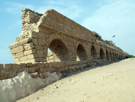 View of the ancient Roman aqueduct in Caesarea, Israel  This aqueduct was built along the Mediterranean Sea photo