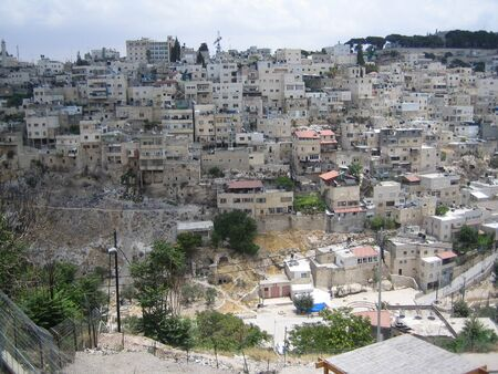 jewish home: Silwan village  Kefar ha-Shiloah  is a predominantly Arab neighborhood on the outskirts of the Old City of Jerusalem  Residential buildings are often located over the ancient Jewish buildings and graves