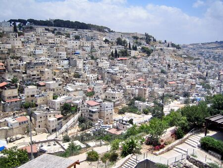 Silwan village  Kefar ha-Shiloah  is a predominantly Arab neighborhood on the outskirts of the Old City of Jerusalem  Residential buildings are often located over the ancient Jewish buildings and graves