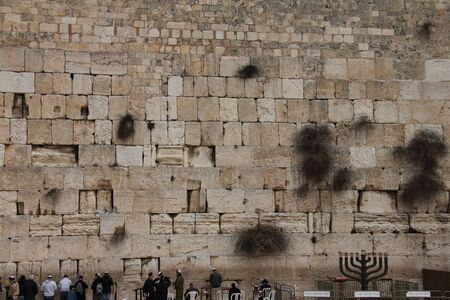 holiest: praying at the holiest Jewish site - Western Wailing wall Editorial