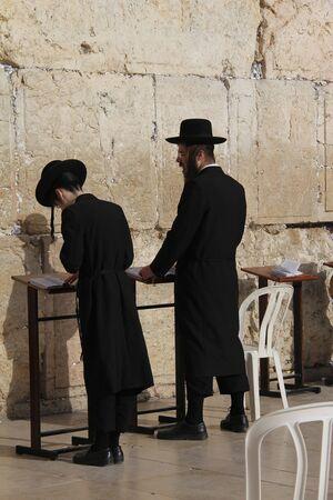 The prayerin western wall in Jerusalem
