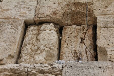 hebrew script: Notes to God in the Western Wall  Jerusalem