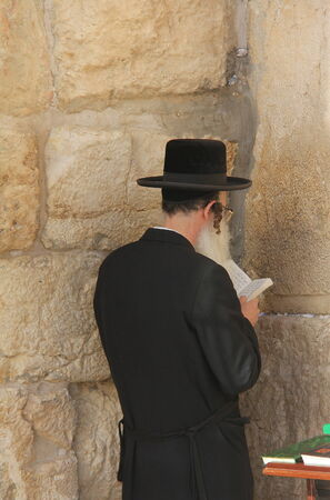 prayer at western wall in Jerusalem