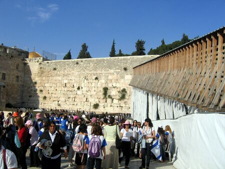 People praying at the holiest Jewish site - Western Wailing wall at night